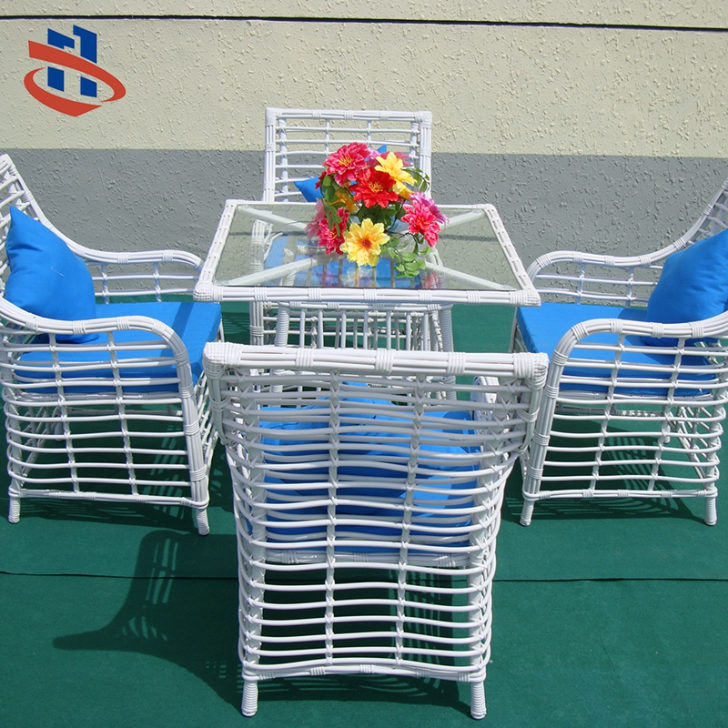 Outdoor rattan furniture dining table set features 2 rattan chairs